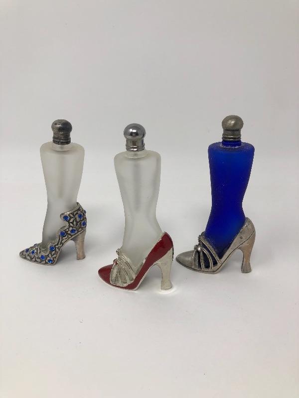 122: Three Highheel Perfume Bottles   EstateSales org
