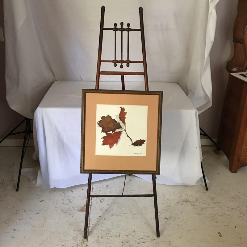 "Lovely wooden easel to display your art or hold your working canvas.  If you don't have any art worth displaying then use this lovely framed artwork by Mr. Stoneberg.. Great piece for your studio or anywhere else in your home or office. Easel measures 61.5"" tall and can collapse for storage.  Local Pickup Only"