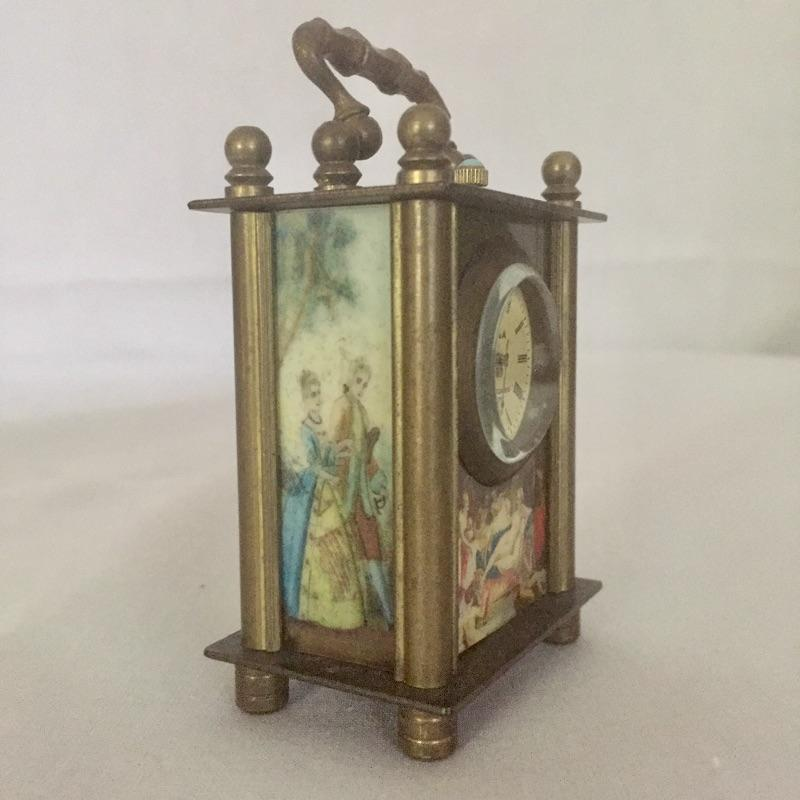 """This adorable Omega Miniature Carriage Clock was made in Switzerland and has colored panels front, back and sides, see images. Clock winds up correctly and seems to keep accurate time.  Clock measures 1"""" x 1.5"""" x 2.25"""". Shipping available."""