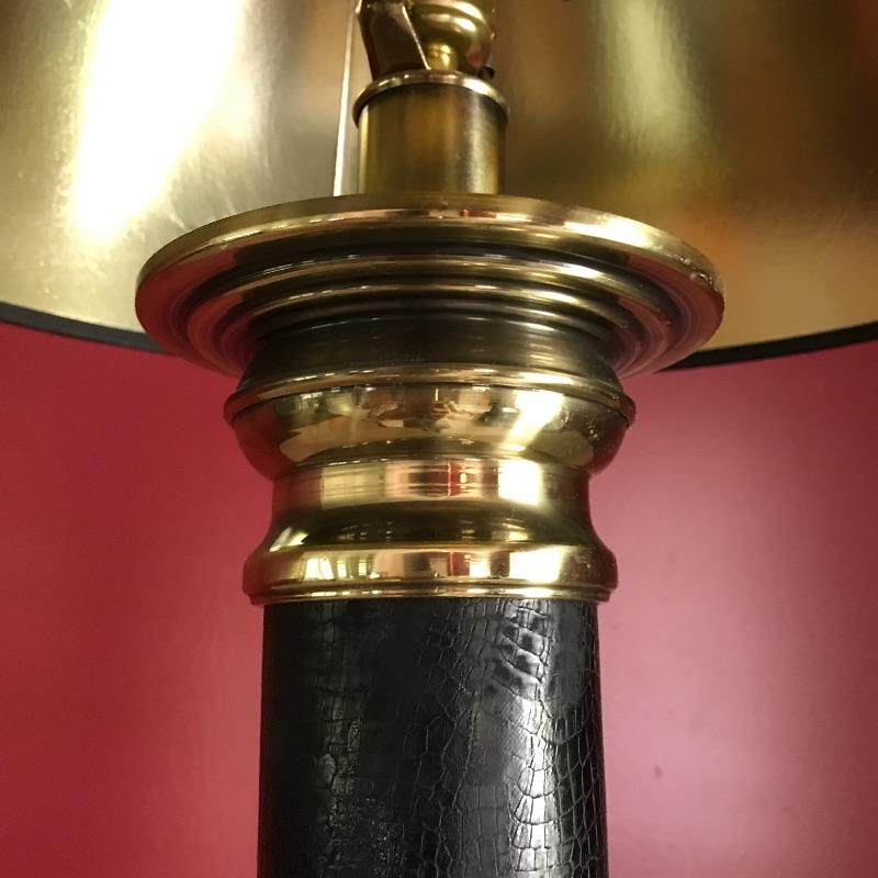 "Brass bankers lamp and heavy table lamp. Light up your life and your home with this elegant  pair of lamps. Black lamp has snake like material on black part. It's Heavy brass that measures 26"" tall.  Local Pickup Only"