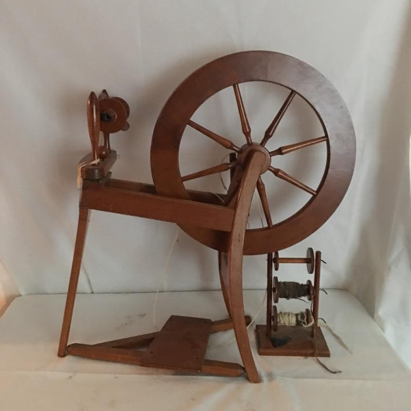 "Quaint spinning wheel. Set up as a unique reminder of the good old days or use it to make something special.  Please note, Spinning wheel has broken leather on treadle and one knob broken - see pictures. Spinning wheel measures 14"" x 33"" x 29"".  Local Pickup Only"