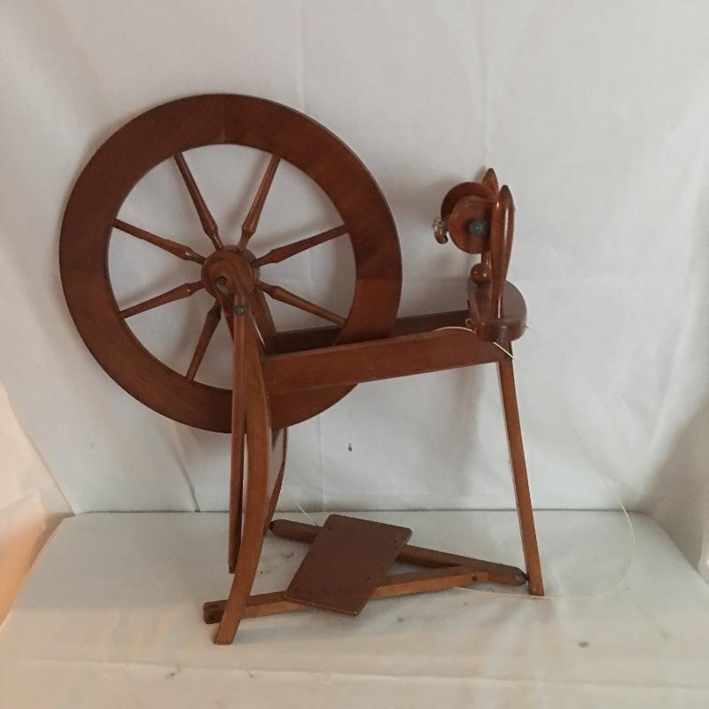 """Quaint spinning wheel. Set up as a unique reminder of the good old days or use it to make something special.  Please note, Spinning wheel has broken leather on treadle and one knob broken - see pictures. Spinning wheel measures 14"""" x 33"""" x 29"""".  Local Pickup Only"""