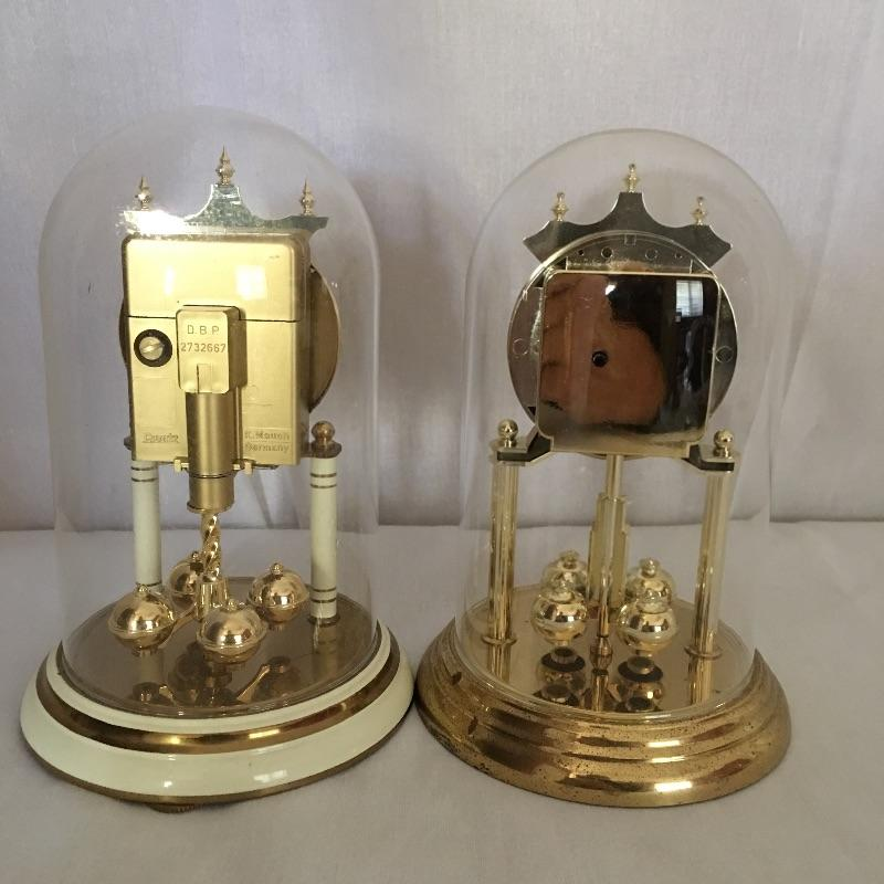 Pair of quartz clocks. Removable glass globe. Batteries are dead so clocks were not tested.  Local Pickup Only