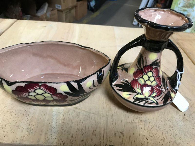 Lot of 2 vintage ceramic vases. All items SOLD AS IS, AS SHOWN and subject to reserve bid. Unsold and Unpaid items will be relisted. Items can be picked up on Wednesday June 5th between 5-7 PM. We can ship small items. For items we do not ship, Buyer can use commercial shipper (UPS, Fedex, etc) Pack and Ship services and we will work with them.