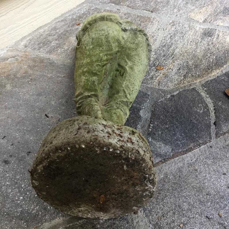 """This """"Grumpy Golfer """" yard art Statue is made of heavy, solid  concrete and the golf club is made of metal. There is a hairline crack on the back of his leg. 8.5"""" wide by 23.5"""" high  Item is for pick up only in Flat Rock, NC, No Shipping."""