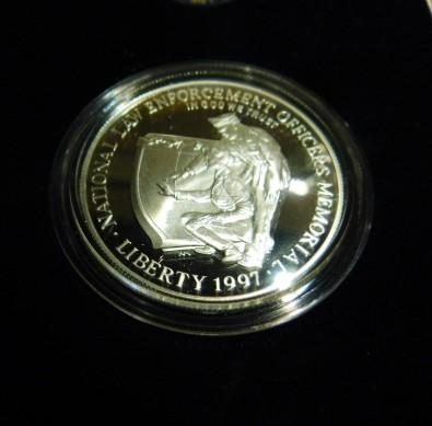 National Law Enforcement 1997 P Insignia Set Officer's Memorial 90% Proof Silver Coin COA in original box with patch and pin.