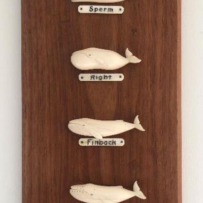 Aletha Macy Hand Carved Whale Figurines on Mahogany