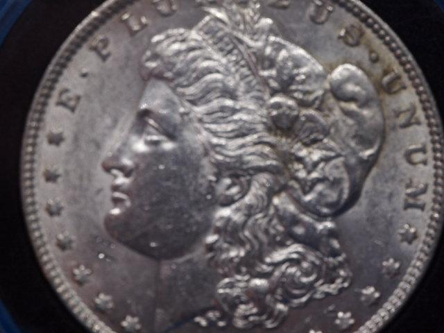 1885 P Morgan Silver Dollar Uncirculated Comes from US Mint and is Guaranteed to be uncirculated as is sealed in a plastic case to protect its condition and Beauty  inventory 120