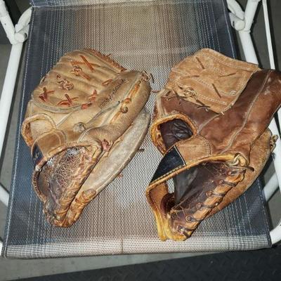 2 baseball gloves