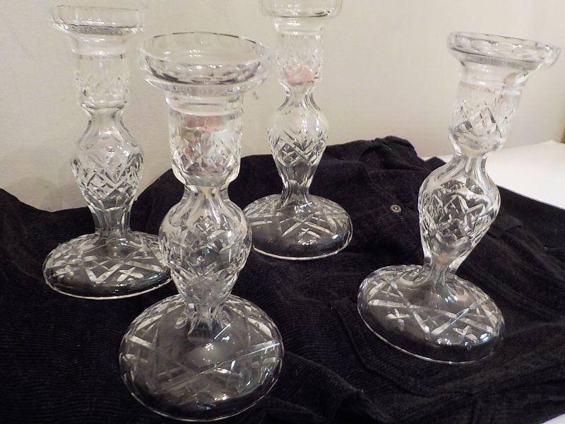 "Eye opening waterford crystal candle holders, A lisemore design, no chips and perfect shape. They are 10 "" in height and have waterford markings. 4 candle holders."