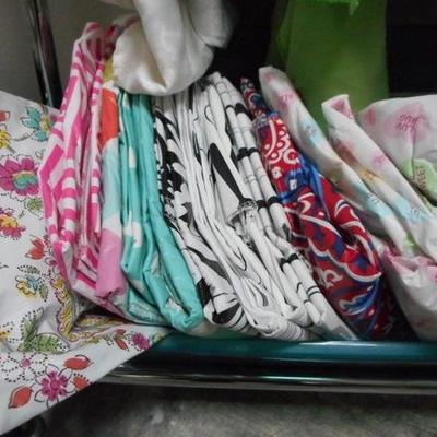 Lot 822 - Wide Assortment of Table Cloths  + Runners and Place Mats + Wheeled Rack