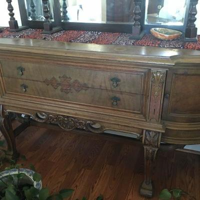 Ornate solid wood buffet and matching dining table and chairs!