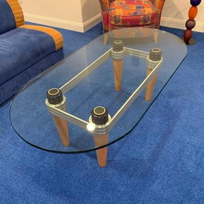 CONTEMPORARY OVAL GLASS TOP AND WOOD LEGGED COCKTAIL TABLE $300