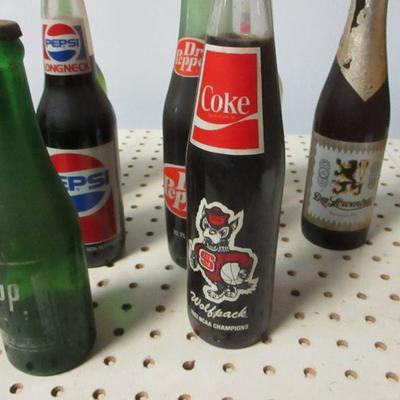 Lot 12 - Soda Bottles - Coke Pepsi Sun Drop 7up