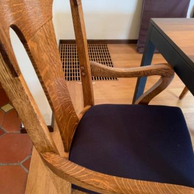 1.  Laminated wood dining table with two leaves, pads and 6 oak chairs