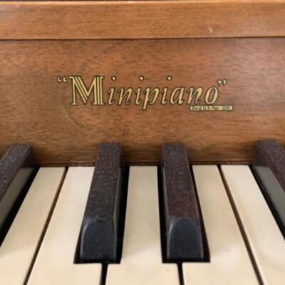 "2. Hardman, Peck & Company Minipiano with bench, music, metronome and desk lamp (55.5"" x 36"" x 17"")"