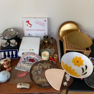 8. Assorted kitchenware (bowls, cutting boards, pizza stone, pewter, thermometer, crock pot, etc.)