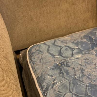 10. Love seat/hide-a-bed in unused pristine condition