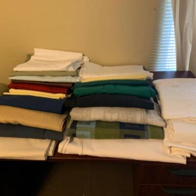 """15. Large collection (18 pieces) of table linens (up to 108"""" in length) in assorted colors and fabrics"""