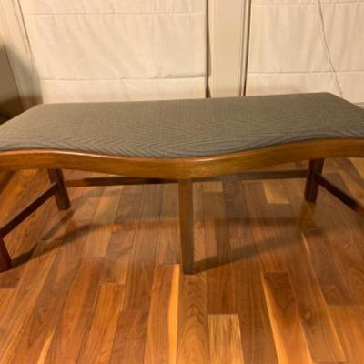 3. Curved Upholstered Wood Framed Bench