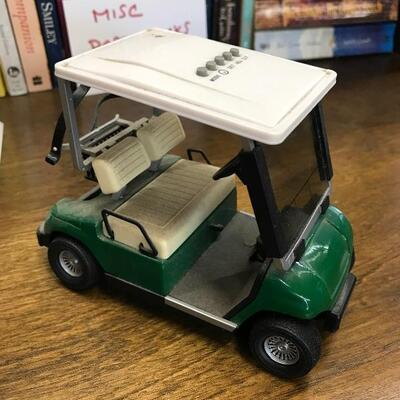 Two Toy Golf Carts (office)