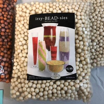 Four Bags of Bowl and Vase Filler Beads