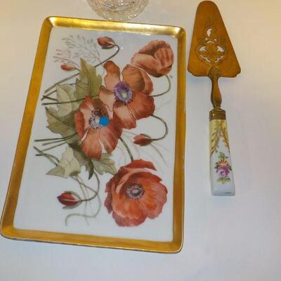 vintage ceramic serving plate and knife with Waterford Vase.