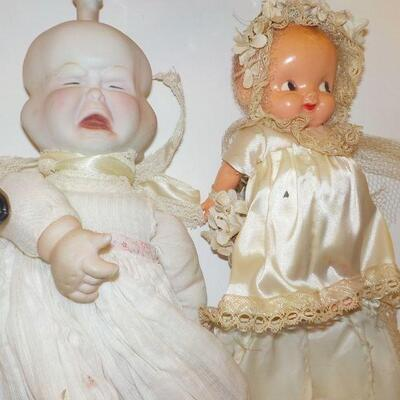 2- vINTAGE - 3 sided face doll vintage and 1900's bisque baby doll.