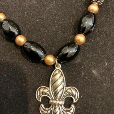 Beautiful black glass bead and silver toned fleur de Lis pendant