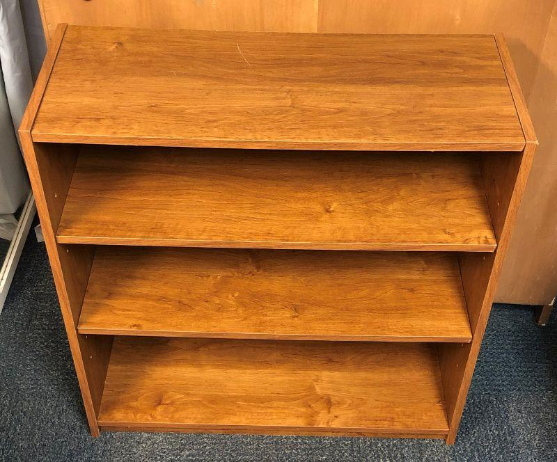 """This is composite wood (otherwise known as pressboard) bookcase that is in overall very good condition.  It is 31.75"""" tall x 29.5"""" wide x 11.5"""" deep."""