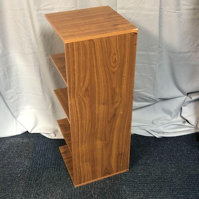 """Except for the one spot where the trim is peeling away a bit (and this part goes in the corner), this shelf unit is in great shape.  It is made of composite (press board) wood and stands 32"""" tall and the shelves are 12"""" square."""