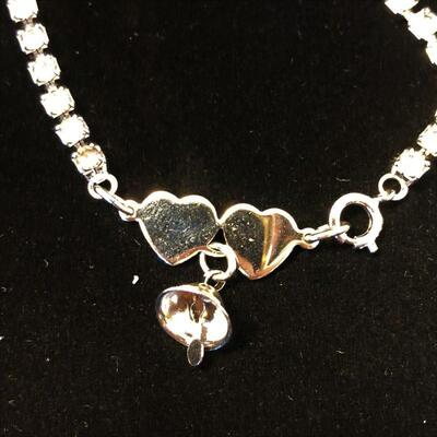 Lot 14 - Clear Stone Tennis Bracelet with Heart Clasp