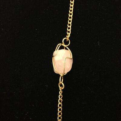 Lot 21 - Pink and Purple Stones on Gold Tone Chain
