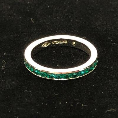 Lot 22 - Sterling Silver Eternity Ring with Green Stones