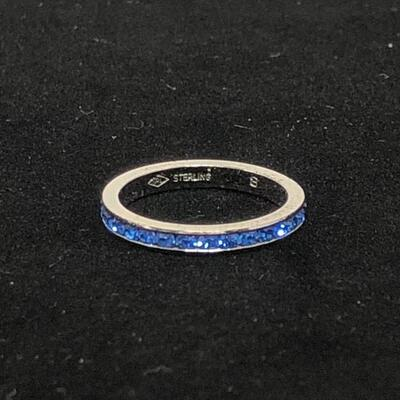 Lot 23 - Sterling Silver Eternity Ring with Blue Stones