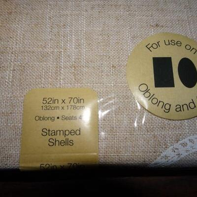 New in Package Oblong or Oval Linen like Beige Tablecloth