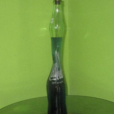 Lot 7 - Stretch Coke Bottle