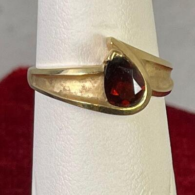 #13 Gold Ruby Ring tests as 14k 3.6 g. can't make out mark