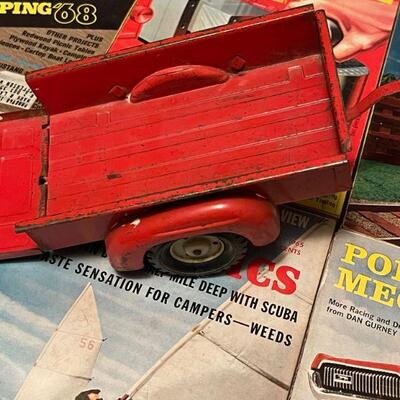 Red metal toy trailer