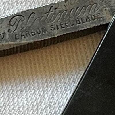Two straight razors / Spike