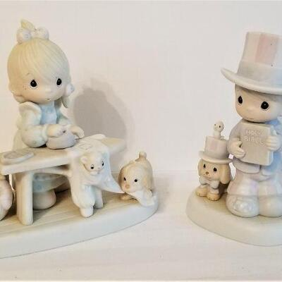 Lot #26  2  Retired Precious Moments Figurines