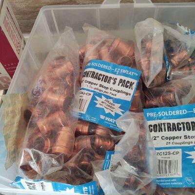 3- Bin of copper couplings, 11 packs of 25