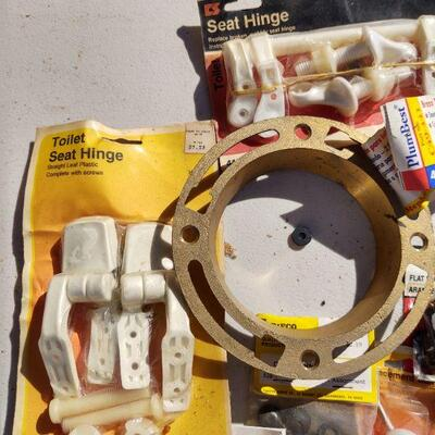 lot 11 - Plumbing parts, brass flange, toilet ball, hinges, joints, washers, valves, etc.