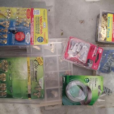 lot 16 - Assorted  hardware, Picture hanging, cable clips screws, etc.
