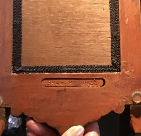 """This unique wooden mirror is 19"""" tall x 8"""" wide"""