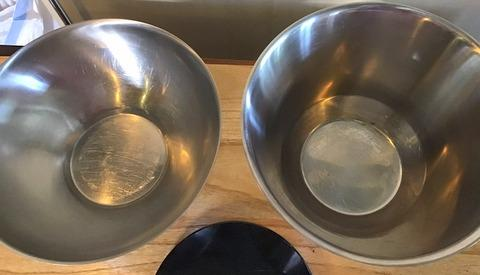 """One bowl is 10.5"""" across the top x 7"""" tall while the other is a tad larger at 11"""" dia. with a height of 5 1/4"""" tall.  The large bowl has a dent in it but the other is in great shape.  The granite trivet is 8"""" dia."""