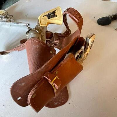Pair of Hubley cap guns with belt and holsters