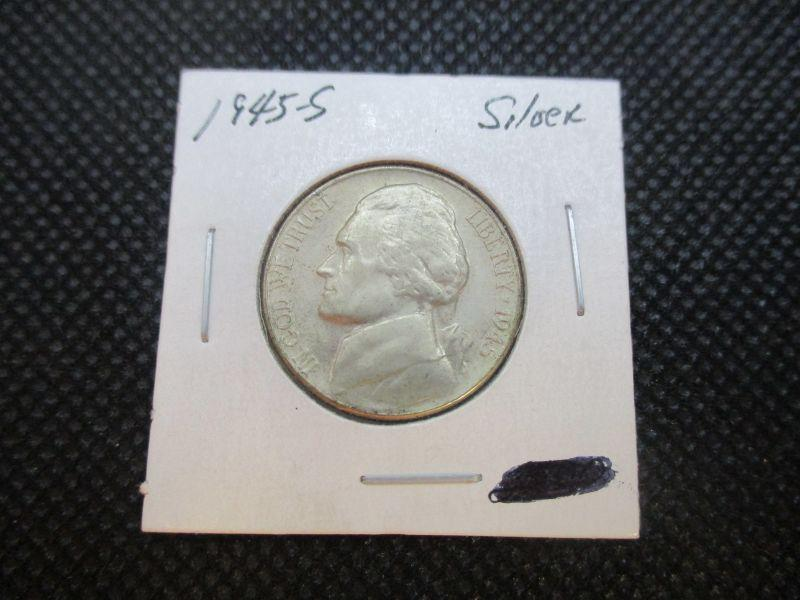 35% Silver content.  Please view the pictures for condition and details.  Use your judgement for grading as this coin was not professionally graded.