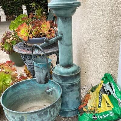 Galvanized metal water pump and bucket