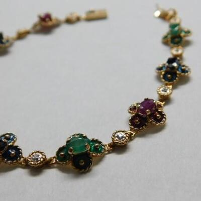 14 KT Gold Bracelet with Emerald, Ruby, and Sapphire Settings 7 grams